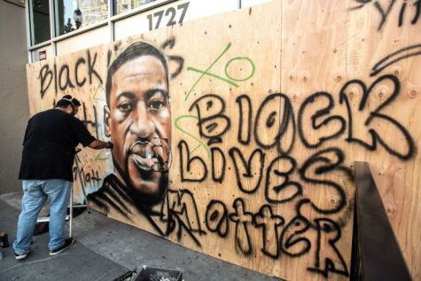 Mandatory Credit: Photo by Chris  Artist AmendTDK paints a mural of George Floyd after the death of George Floyd. Black Lives Matter protest, Oakland, California, USA - 30 May 2020